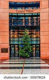 STRASBOURG, FRANCE - DECEMBER 21, 2014: Complex of European Parliament in Wacken district of Strasbourg. It is one of biggest and most visible buildings of Strasbourg. Detail of entrance.