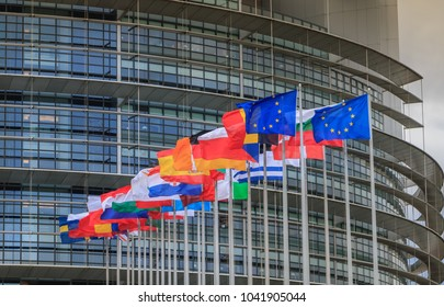 Strasbourg, France - December 28, 2017: Set of European flags in front of the European Parliament on a winter day