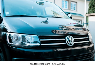 STRASBOURG, FRANCE - FEB 12, 2017: Volkswagen logotype on the luxury black van front. Volkswagen shortened to VW, is a German automaker founded on 4 January 1937 by the German Labour Front