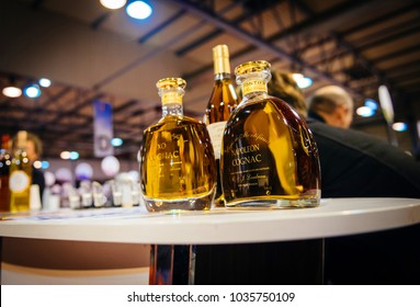 STRASBOURG, FRANCE - FEB 19, 2018: Bootles of Napoleon Cognac VSOP French wine at the Vignerons independant English: Independent winemakers of France wine fair in Strasbourg
