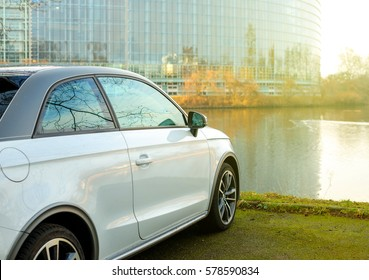 STRASBOURG, FRANCE - FEB 2, 2017: Audi A1 car parked in front of the European Parliament building in Strasbourg, Alsace France