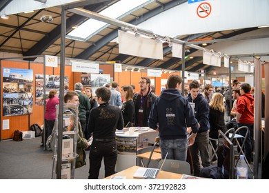 STRASBOURG, FRANCE - FEB 4, 2016: Children and teens of all ages attending annual Education Fair to choose career path and receive vocational counseling - busy college stand