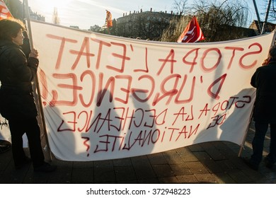 STRASBOURG, FRANCE - FEB 6, 2016: Shadows of protesters on placards while they are marching during a demonstration against government's plan to extent the 'state of emergency' and for opened borders