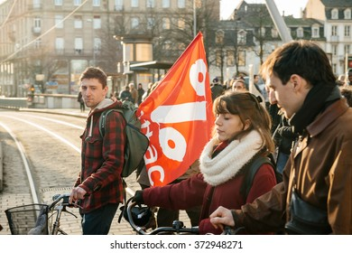 STRASBOURG, FRANCE - FEB 6, 2016: Communist flags in hands of protesters marching during a demonstration against government's plan to extent the 'state of emergency' and for opened borders