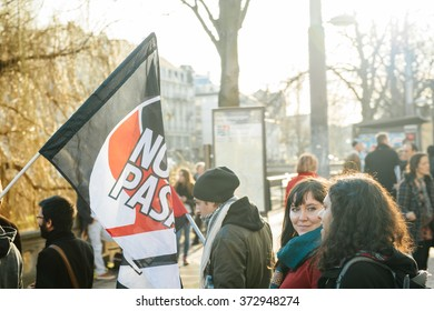 STRASBOURG, FRANCE - FEB 6, 2016: No Psaram flag flag with the protesters marching during a demonstration against government's plan to extent the 'state of emergency' and for opened borders