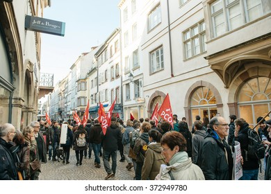 STRASBOURG, FRANCE - FEB 6, 2016: Protesters marching during a demonstration against government's plan to extent the 'state of emergency' and for opened borders on busy shopping street