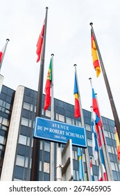 STRASBOURG, FRANCE - FEBRUARY 04, 2015: Exterior of Council of Europe with all European Union member flags and street avenue name of President Robert Schumann