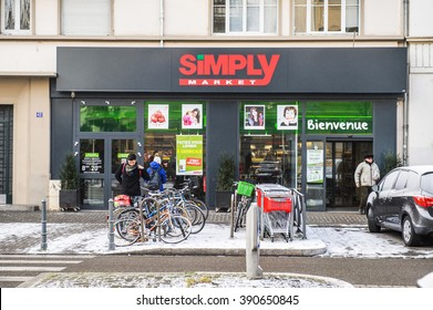 STRASBOURG, FRANCE - JAN 20, 2016: Modern SIMPLY Supermarket in the French city of Strasbourg on a snowy winter day - Simply Market is a brand of French supermarkets Auchan formed in 2005.