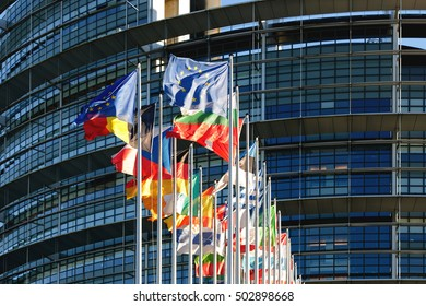 STRASBOURG, FRANCE - JAN 28, 2014:  All European Union flags in a row waving in front of the European Parliament building in Strasbourg, Alsace France brexit