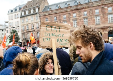 STRASBOURG, FRANCE - JAN 30, 2016: Protesting government's plan of the extension of the 'state of emergency' for another three months - holding placard - Emergency State - Racist State,