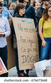 STRASBOURG, FRANCE - JUL 12, 2017: Woman waring placard in city as Melenchon called for day of protest against Macron government spending cuts and pro-business tax and labor reforms