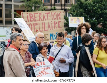 STRASBOURG, FRANCE - JUL 12, 2017: Large crowd of protesters in city as Melenchon called for day of protest against Macron government spending cuts and pro-business tax and labor reforms