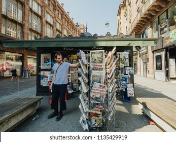 STRASBOURG, FRANCE - JUL 16, 2018: French man buying newspaper announcing France champion title after French national football team won their FIFA World Cup 2018 final game against Croatia in Moscow