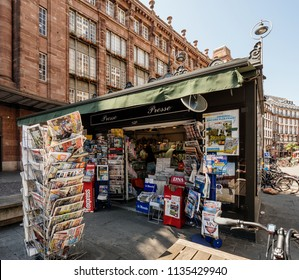 STRASBOURG, FRANCE - JUL 16, 2018: French kiosk with newspapers announcing France champion title after French national football team won their FIFA World Cup 2018 final game against Croatia in Moscow