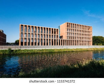 STRASBOURG, FRANCE - JUL 18, 2018: Modern Turkish embassy in Strasbourg on Quai Jacoutot Ill River with calm canal water