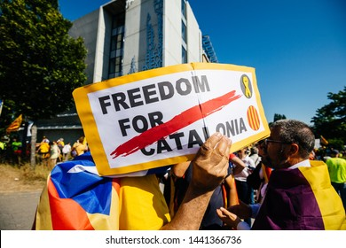 Strasbourg, France - Jul 2 2019: Man holding placard Freedom for Catalonia at protest front of EU European Parliament against exclusion of three Catalan elected MEPs