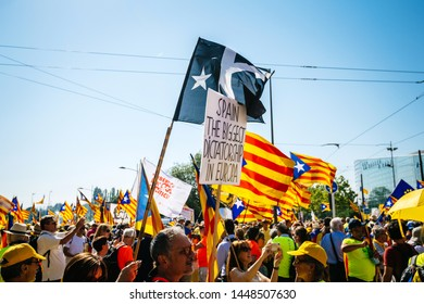 Strasbourg, France - Jul 2 2019: Placard Spain the biggest dictatorship in Europe separatist flags demonstrate protest front of EU European Parliament against exclusion of three Catalan elected MEPs