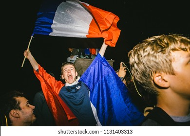 STRASBOURG, FRANCE - JULY 10, 2018: man with French National Flag yelling happy after the victory of France qualify for the final of the 2018 FIFA World Cup after their victory over Belgium 1-0