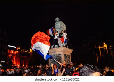 STRASBOURG, FRANCE - JULY 10, 2018: Waving French flag Central Place Kleber after the victory of France qualify for the final of the 2018 FIFA World Cup after their victory over Belgium 1-0
