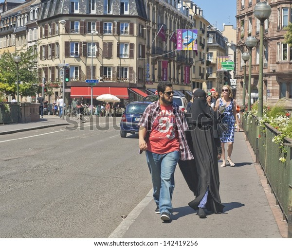 STRASBOURG, FRANCE - JULY 16: A woman in a niqab is walking down the street in Strasbourg, despite the law that prohibit to walk with covered face in July 16, 2011
