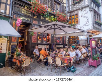 Strasbourg, France - July 25, 2018: Shops and restaurants around Place de la Cathedrale in Strasbourg, France. There are many restuarants, bars and tourist shops close to Notre Dame cathedral.
