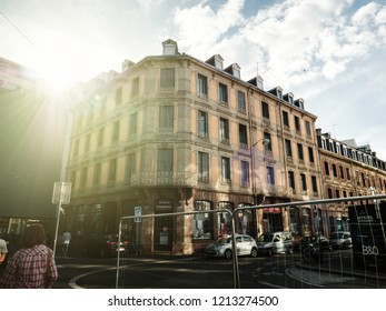 STRASBOURG, FRANCE - JUN 23, 2018: Toto Tissues store in Strasbourg with beautiful building and Rue Marbach and Rue Thomann intersection sunlight flare