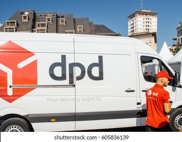 27095d6ebb9769 STRASBOURG  FRANCE - JUN 24  2016  White parcel DPD delivery van driver  worker