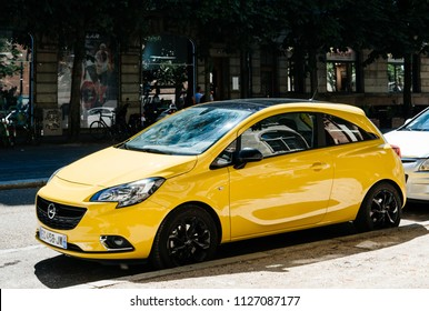 STRASBOURG, FRANCE - JUNE 10, 2017: New yellow Opel Corsa parked on the street in France