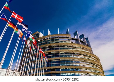 STRASBOURG, FRANCE - JUNE 15, 2017 -  View of European parliament in Strasbourg with blue sky and flags of European countries in the wind