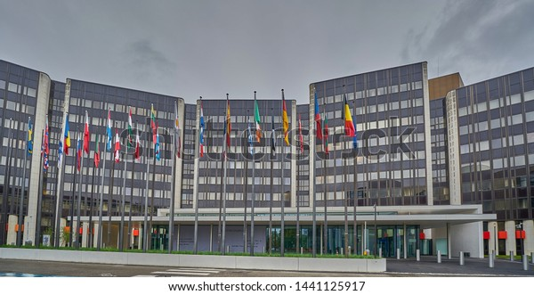 Strasbourg, France - June 15 2019: The European Parliament building in Strasbourg. Flags of the member states fly on flagpoles outside.