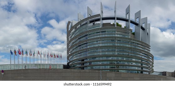 STRASBOURG, FRANCE - JUNE 18, 2018: modern architecture of european union parliament with flags of members in france, alsace, france