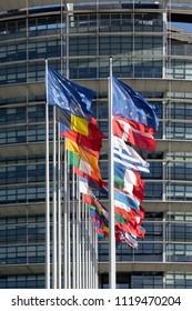 STRASBOURG, FRANCE - JUNE  23, 2018: All EU Flags European Union flag waving in front of European Parliament, headquarter of the European Commission European Parliament
