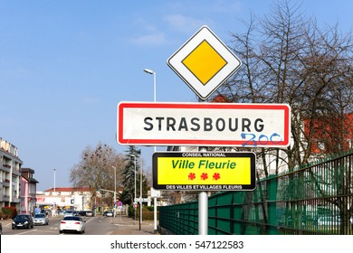 STRASBOURG, FRANCE - MAR 20, 2016: Strasbourg Ville Fleurie sign - translating as Blooming City - at the entrance of Strasbourg, Alsace France with cars and houses in the background