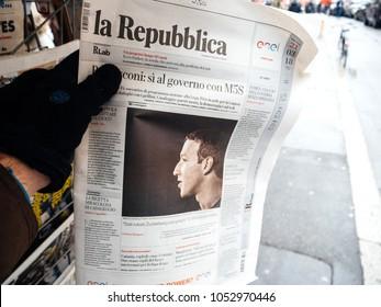 STRASBOURG, FRANCE  - MAR 22, 2018: Man reading buying Italian La Republica newspaper at press kiosk featuring Mark Zuckerberg, Facebook CEO - scandat data leaks from Cambridge Analytica