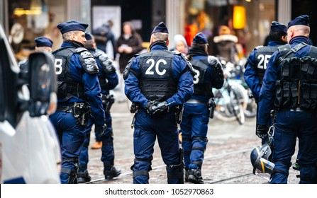 STRASBOURG, FRANCE  - MAR 22, 2018: Police force surveillance of demonstration protest against Macron French government string of reforms, mutiple trade unions have called public workers to strike