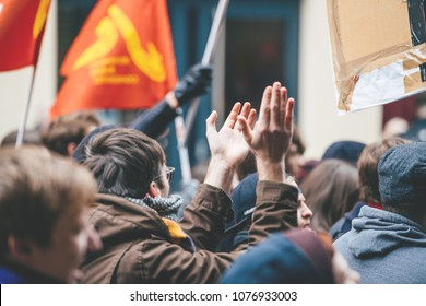 STRASBOURG, FRANCE  - MAR 22, 2018: Making noise hands demonstration protest against Macron French government string of reforms, mutiple trade unions called public workers to strike
