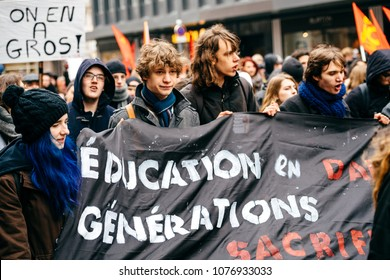 STRASBOURG, FRANCE  - MAR 22, 2018: Students education placard at demonstration protest against Macron French government string of reforms, mutiple trade unions called public workers to strike