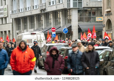STRASBOURG, FRANCE - MAR 22, 2018: CGT General Confederation of Labour workers with placard at demonstration protest against Macron French government string of reforms - closed central street full