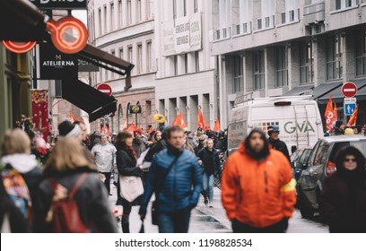STRASBOURG, FRANCE - MAR 22, 2018: CGT General Confederation of Labour workers with placard at demonstration protest against Macron French government string of reforms - pedestrians on trottoir with