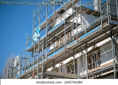 Strasbourg, France - Mar 22, 2020: Scaffolding installed on old house facade with logotype of Nonnenmacher et Fils