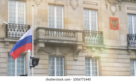 STRASBOURG, FRANCE - MAR 28, 2018: Flag of Russia flying half-mast ar Russian Consulate Embassy - tribute and mourning of victims of fire at Zimnyaya Vishnya Winter Cherry shopping centre Kemerovo