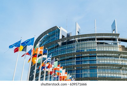 STRASBOURG, FRANCE - MAR 31, 2017:The European Parliament building in Strasbourg, France with flags waving calmly celebrating peace of the Europe