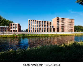 STRASBOURG, FRANCE - MAR 5, 2018: Future Turkish embassy in Strasbourg on Quai Jacoutot Ill River with calm canal water