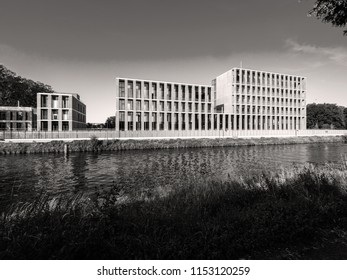 STRASBOURG, FRANCE - MAR 5, 2018: Future Turkish embassy in Strasbourg on Quai Jacoutot Ill River with calm canal water - black and white