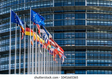 STRASBOURG, FRANCE - MARCH 5, 2018: Flags of european countries waving in the courtyard of the Louise Weiss building, seat of the European Parliament located in Strasboug, France