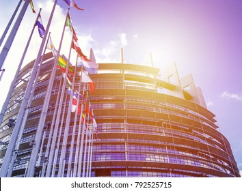STRASBOURG, FRANCE MAY 12 2017: EU Parliament building with flags in sun light. Background for European news