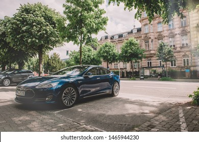 Strasbourg, France - May 19, 2016: Vintage filter over modern luxury Tesla Model S 90D electric supercar in beautiful blue color parked on the French street