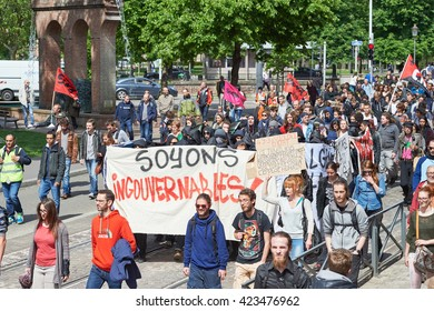 STRASBOURG, FRANCE - MAY 19, 2016: LArge group of people with diverse placards during a demonstrations against proposed French government's labor and employment law reform