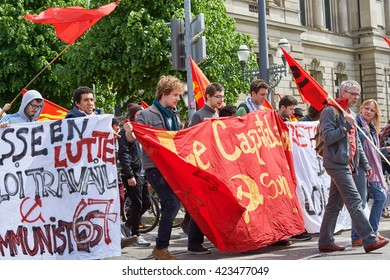 STRASBOURG, FRANCE - MAY 19, 2016: Young say no to labor low placard during a demonstrations against proposed French government's labor and employment law reform