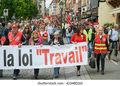 STRASBOURG, FRANCE - MAY 19, 2016: People marching on closed central streets in Strasbourg with retire labor reform placard during a demonstration against proposed French government's reform